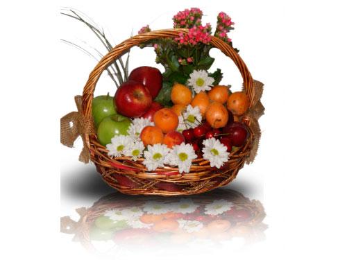 Cesta de frutas y margaritas para madres